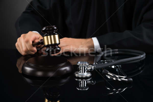 Close-up Of Judge Hitting Gavel With Stethoscope Stock photo © AndreyPopov
