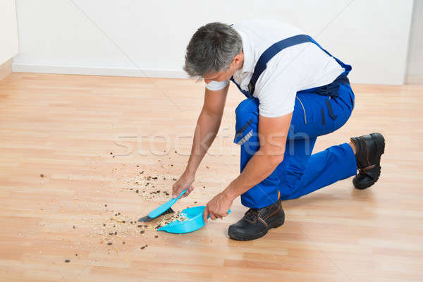 Janitor Sweeping Floor With Brush And Dustpan Stock photo © AndreyPopov