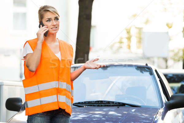 Woman Using Mobile Phone With Broken Down Car On Street Stock photo © AndreyPopov