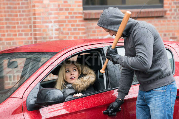 Robber Holding Baseball Bat While Looking At Woman In Car Stock photo © AndreyPopov