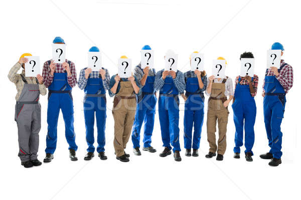 Construction Workers Hiding Faces With Question Mark Signs Stock photo © AndreyPopov