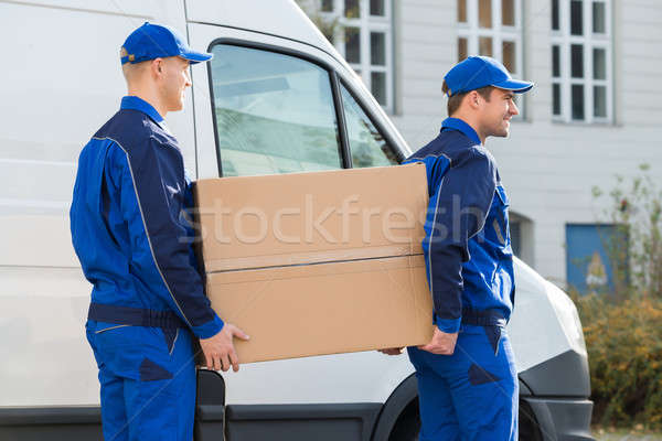 Delivery Men Carrying Cardboard Box By Truck Stock photo © AndreyPopov