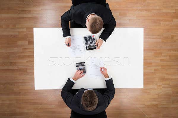 Empresários secretária escritório diretamente acima tiro Foto stock © AndreyPopov