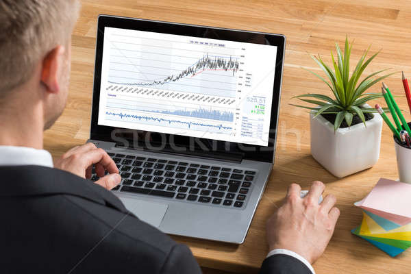 Male Stock Market Broker Working On Laptop Stock photo © AndreyPopov