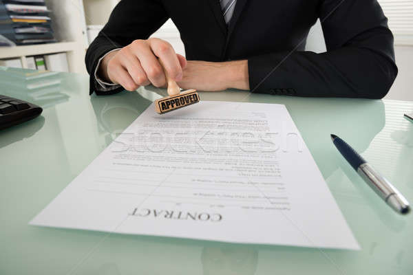 Businessman Stamping On Contract Paper Stock photo © AndreyPopov