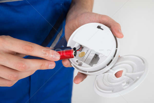 Stock photo: Electrician Holding Smoke Detector