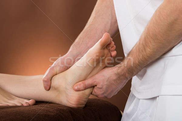 Donna piedi massaggio spa primo piano maschio Foto d'archivio © AndreyPopov