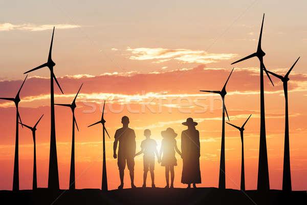 Silhouette famiglia mulino a vento uomo Coppia tecnologia Foto d'archivio © AndreyPopov