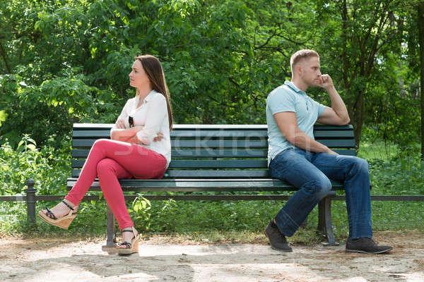 Elégedetlen pár ül pad fiatal pér park Stock fotó © AndreyPopov