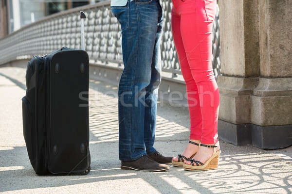 Couple Standing On Bridge With Luggage Stock photo © AndreyPopov
