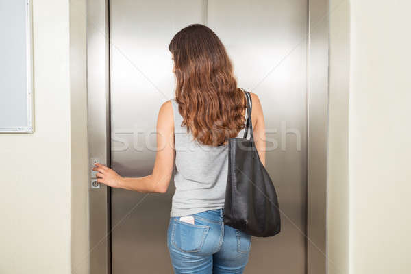 Woman With Handbag Using Elevator Stock photo © AndreyPopov