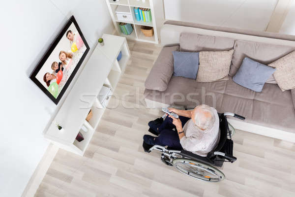 Handicapped Grandmother Watching Television At Home Stock photo © AndreyPopov