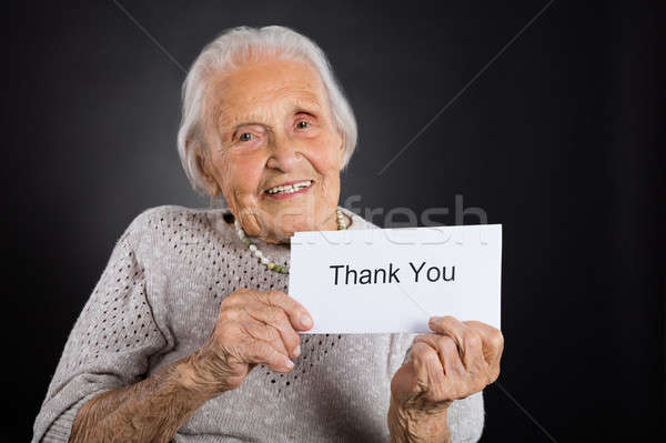 Elder Woman Showing Thank You Card Stock photo © AndreyPopov