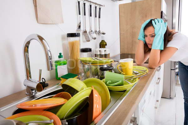 Tired Woman Standing In The Kitchen Stock photo © AndreyPopov