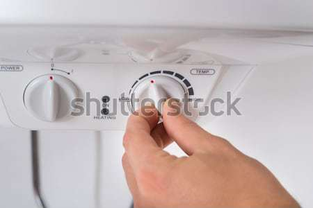 Person Operating Air Conditioner With Remote Control Stock photo © AndreyPopov