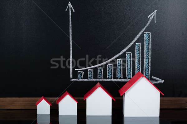 House Models In Front Of Blackboard Showing Graph Stock photo © AndreyPopov