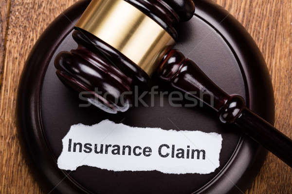 Insurance Claim Concept On Wooden Gavel Stock photo © AndreyPopov