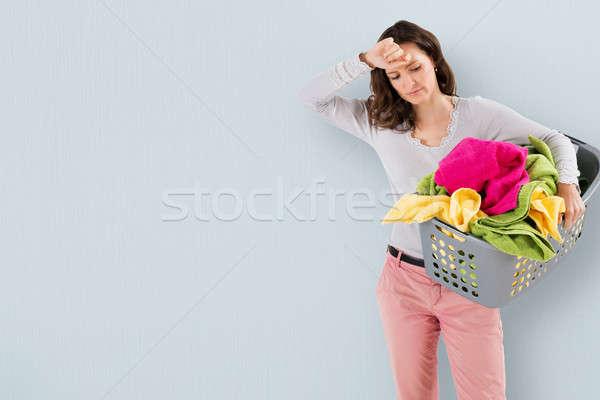 Fatigué femme panier à linge jeunes panier Photo stock © AndreyPopov