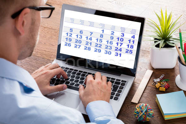 Businessperson Looking At Calendar On Laptop Stock photo © AndreyPopov