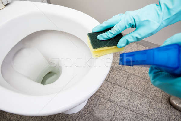 Person Hand Cleaning Toilet Using Sponge Stock photo © AndreyPopov