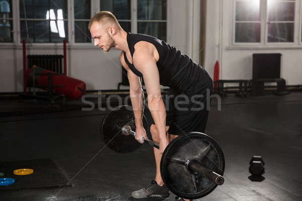 Young Man Lifting Barbell Stock photo © AndreyPopov