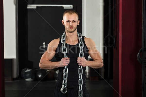 Atleta homem metal cadeia retrato Foto stock © AndreyPopov