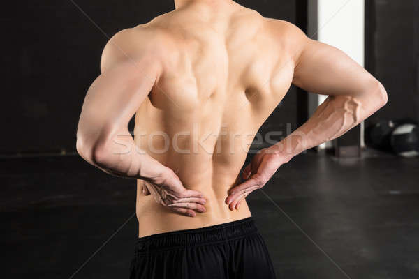Man With His Back Pain Stock photo © AndreyPopov