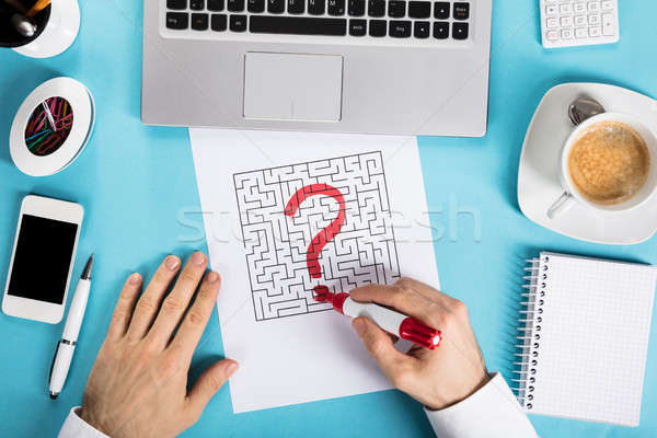 Businessman Drawing Question Mark Icon On Labyrinth Maze Stock photo © AndreyPopov