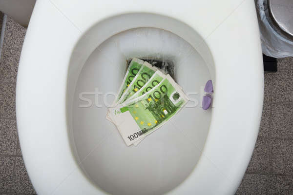 Euro Notes In The Toilet Bowl Stock photo © AndreyPopov