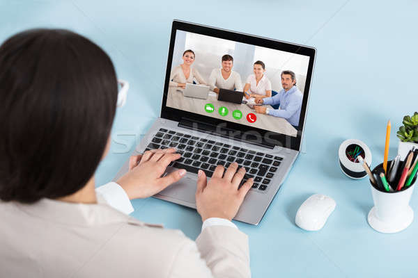 Stock photo: Businesswoman Doing Video Conference On Laptop