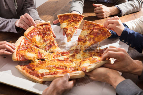 Csoport üzletemberek eszik pizza közelkép elvesz Stock fotó © AndreyPopov