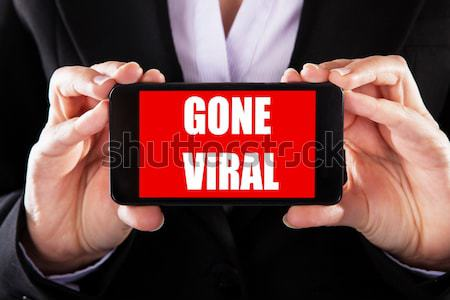 Text Gone Viral On Smartphone Display Stock photo © AndreyPopov