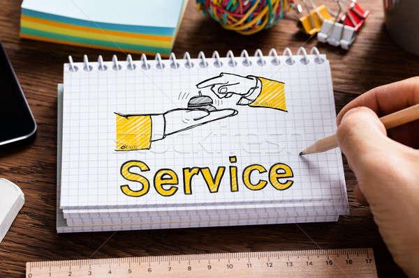 Vendégszeretet szolgáltatás férfi rajz jegyzettömb kéz Stock fotó © AndreyPopov