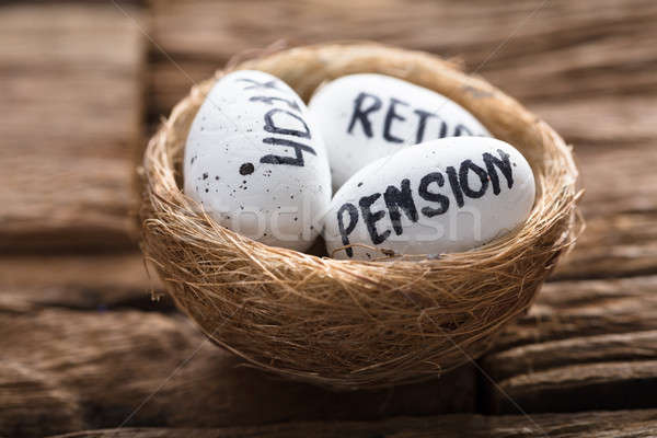 Pension  401K And Retire Written On White Eggs In Nest Stock photo © AndreyPopov