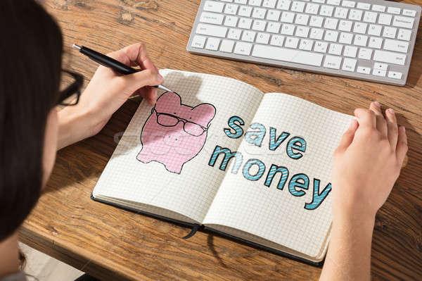 Személy rajz megtakarítás könyv közelkép pénz Stock fotó © AndreyPopov