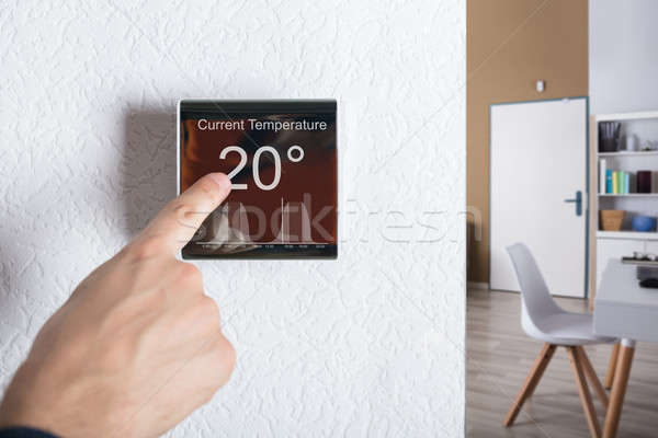 Touching Digital Thermostat Stock photo © AndreyPopov
