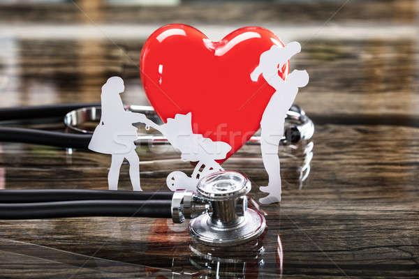 Közelkép család kivágás piros szív sztetoszkóp Stock fotó © AndreyPopov