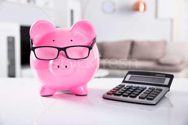 Różowy skarbonka okulary Kalkulator Zdjęcia stock © AndreyPopov