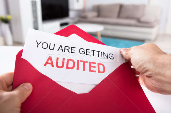 Person Holding You Are Getting Audited Card In Envelope Stock photo © AndreyPopov