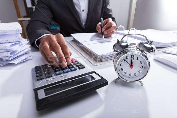 ビジネスパーソン 電卓 法案 目覚まし時計 デスク クロック ストックフォト © AndreyPopov