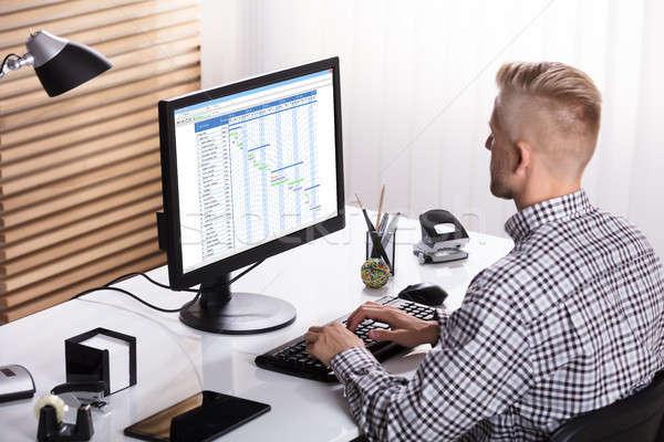 Businessman Working On Gantt Chart Stock photo © AndreyPopov