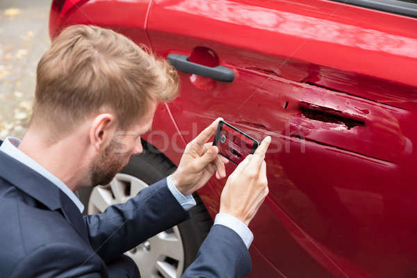 Person Taking Picture Of Damaged Car Stock photo © AndreyPopov
