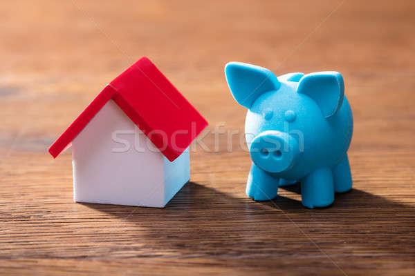 House Model And Piggybank On Table Stock photo © AndreyPopov