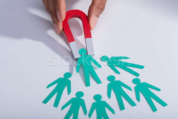 Businessperson Holding Magnet Attracting Paper Candidates Stock photo © AndreyPopov