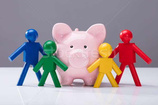 Close-up Of Piggybank And Human Figures Stock photo © AndreyPopov