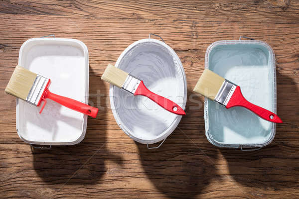 Different Size Of Paint Brush On Container Stock photo © AndreyPopov