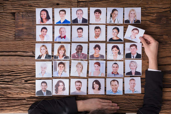 Businessperson Choosing Photograph Of Candidate Stock photo © AndreyPopov