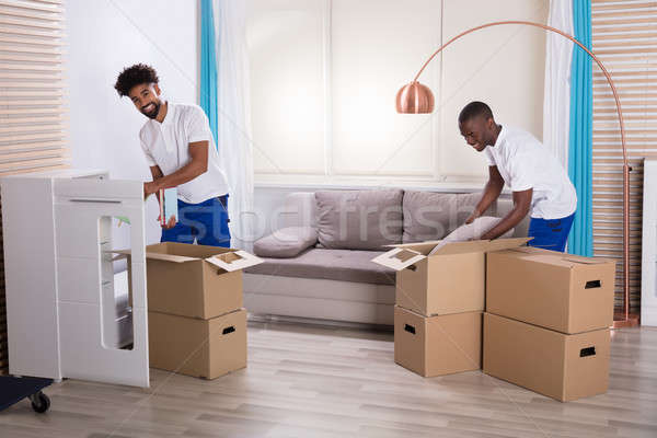Movers Unpacking The Cardboard Boxes In The Home Stock photo © AndreyPopov