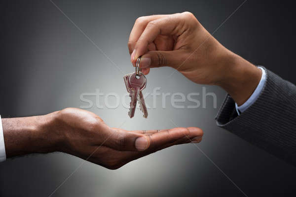 Hand Passing Keys To New Owner Stock photo © AndreyPopov