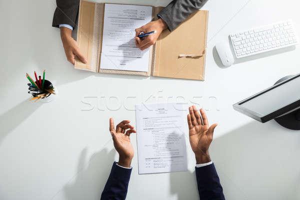 üzletember kéz fehér asztal kilátás önéletrajz Stock fotó © AndreyPopov
